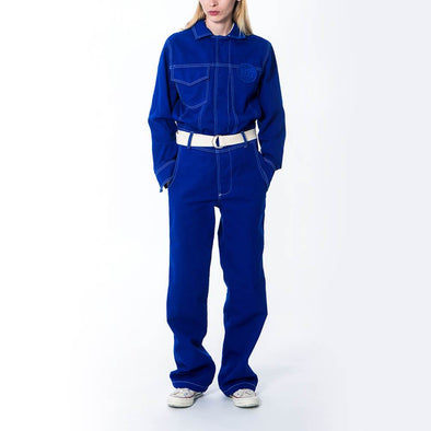 Unisex blue workwear jumpsuit with hidden press studs and embroidered logo patch.