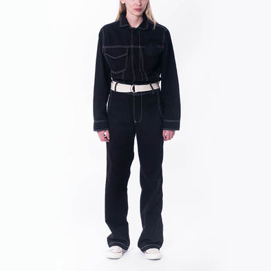 Unisex black workwear jumpsuit with hidden press studs and embroidered logo patch.