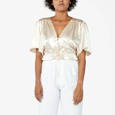 Champagne satin blouse with mid-legnth flowy sleeves.