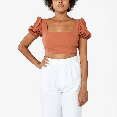 Brick orange square neck top with short balloon sleeves.