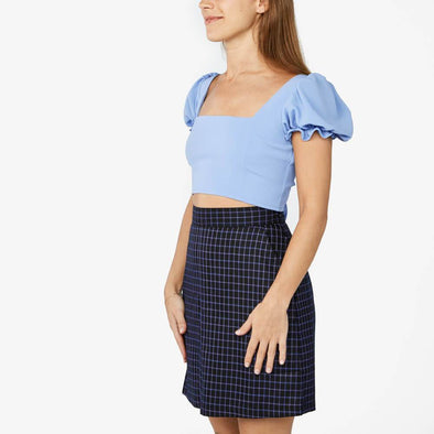 Light blue square neck top with short balloon sleeves.