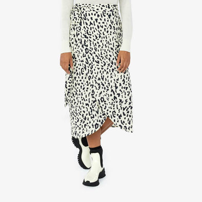 White midi wrap-up skirt with a black animal print.