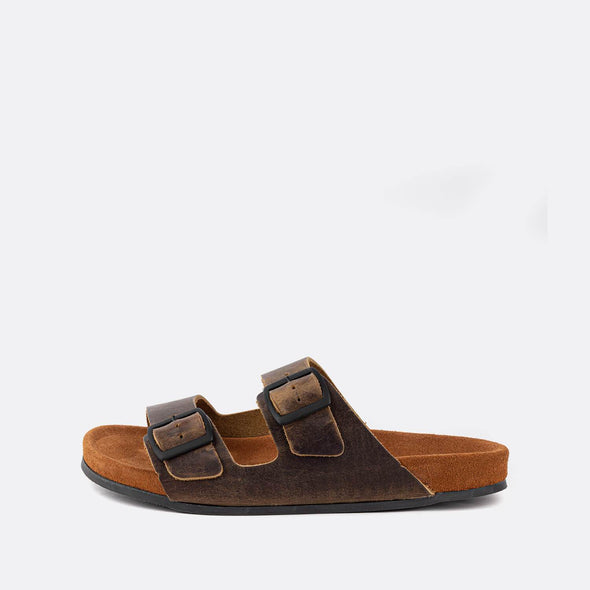 Double-strap adjustable sandals in dark brown with brown sole.