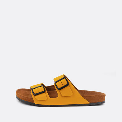 Double-strap adjustable sandals in yellow with brown sole.