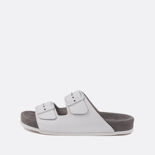 Double-strap adjustable sandals in white with grey sole.