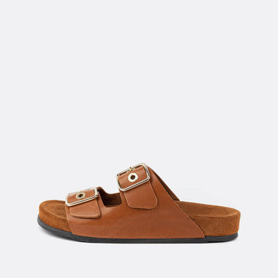 Double-strap adjustable sandals in brown with brown sole.