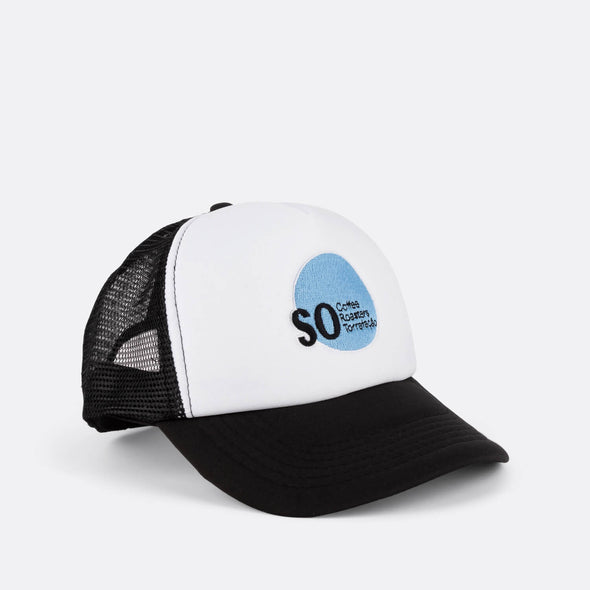 Brand trucker hat in white, blue and black with front logo print.