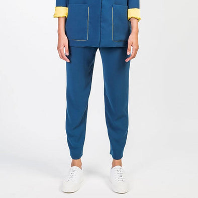 Cigarrette blue pants with mide-rise deep front crotch seam and loose darts on front side pocket and invisible side zipper.