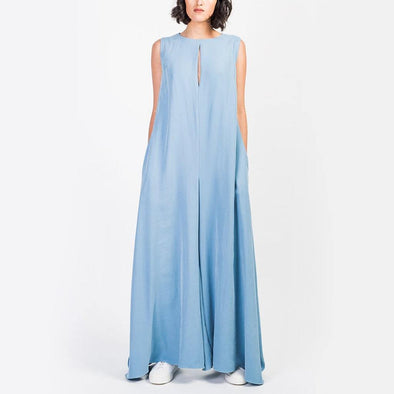 Oversized blue jumpsuit with neckline opening and sleeveless design featuring invisible zipper on the back.