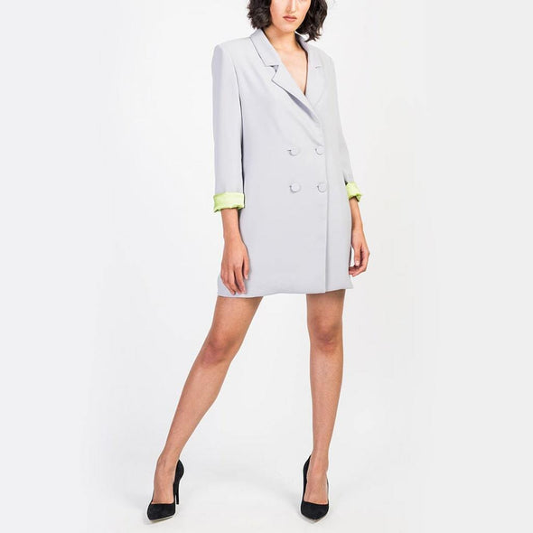 Blazer dress in grey with four central buttons.