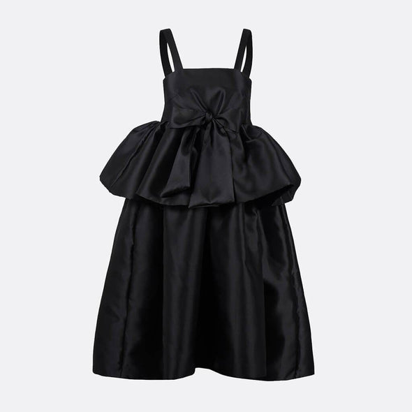 100% polyester midi black dress with straps and oversize chest ruffle and bow.
