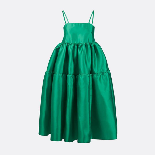 100% polyester long dress in green with spaghetti straps, two ruffles and string fastening on the back.