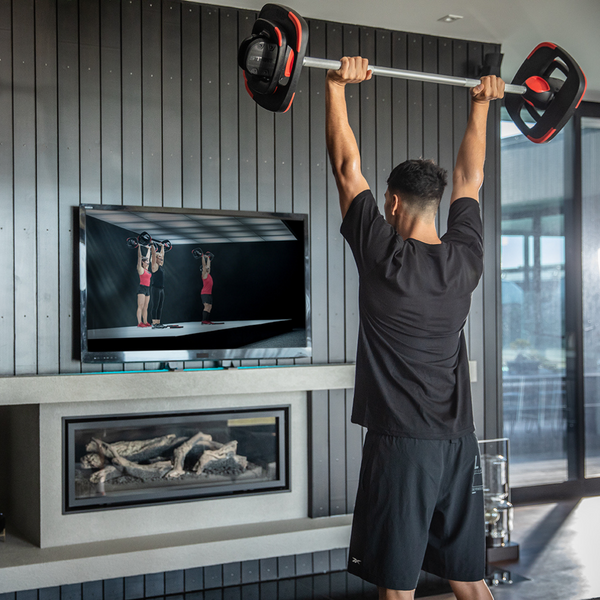 Man using the Les Mills Smart Bar during a workout