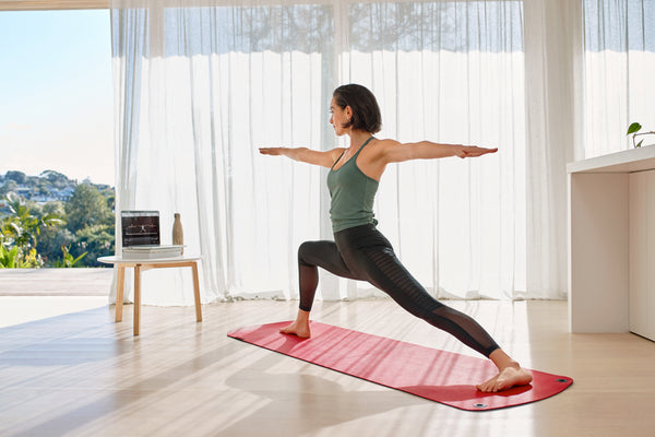 Woman using the MBX mat to do a yoga workout