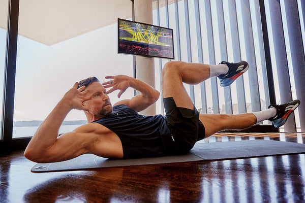 Man performing a core workout at home