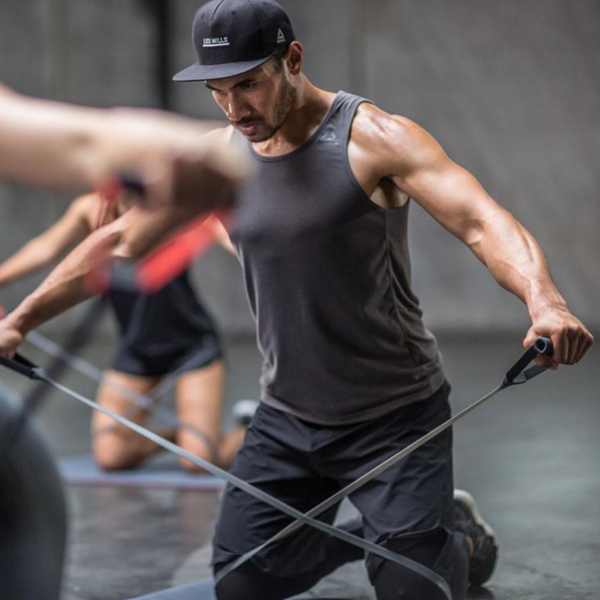 Les Mills Instructor using a SMARTBAND while exercising