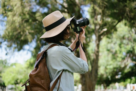 A person shooting outdoors with their digital camera