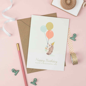 Hedgehog with colourful balloons birthday card for children.