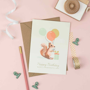 Squirrel with colourful balloons birthday card for children.