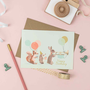 Woodland Animal Parade showing a squirrel, rabbit and hedgehog Happy Birthday Card