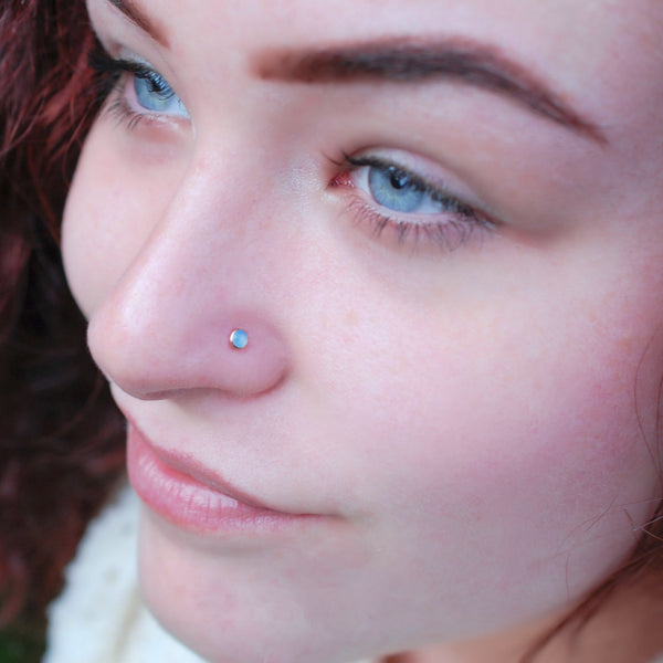 14 karat rose gold nose stud with blue chalcedony