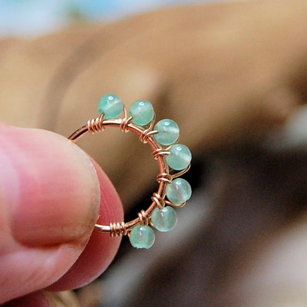 green aventurine wrapped nose stud in 14 karat rose gold