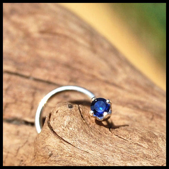 dainty sapphire nose stud set in sterling silver