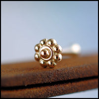 dainty flower nose stud in 14k yellow gold