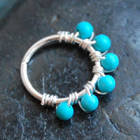sterling silver nose hoop wrapped with turquoise gemstones