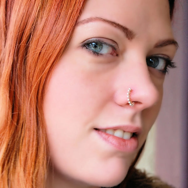 14 karat rose gold nose ring wrapped with nickel-free sterling silver