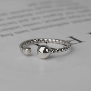 Open simple twist ball ring