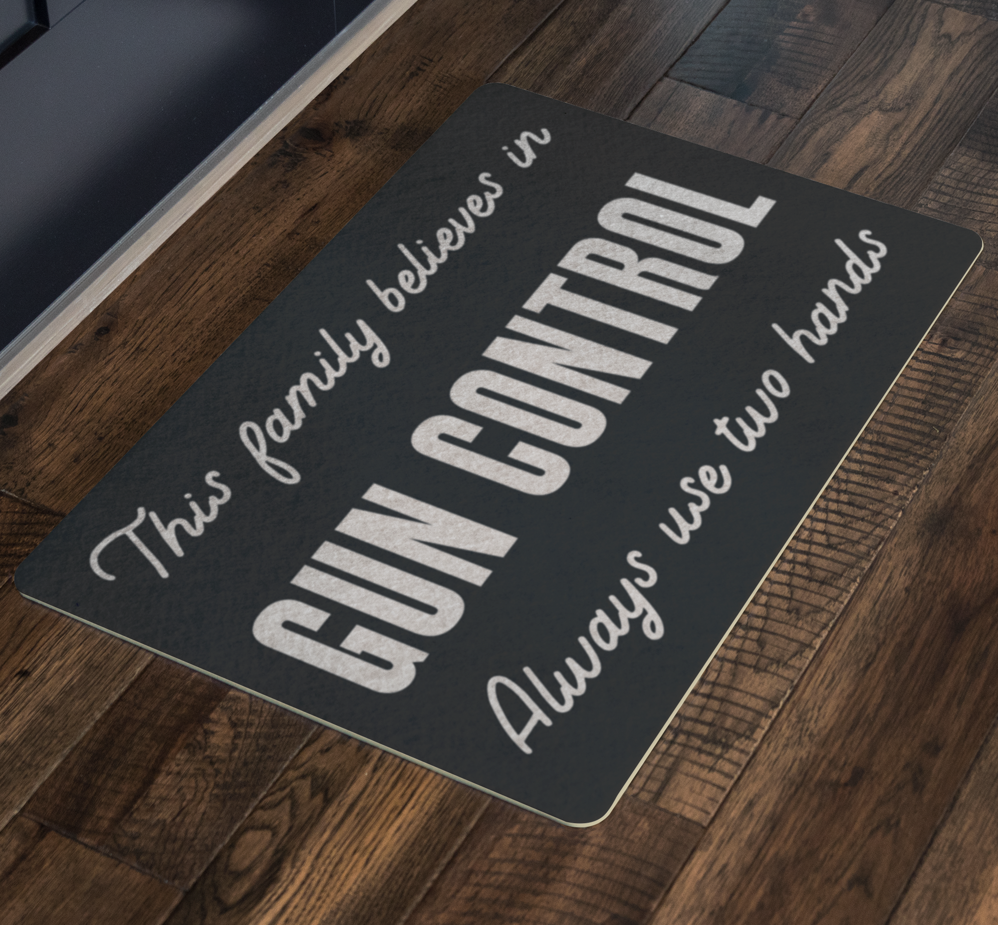 THIS FAMILY  BELIEVES IN GUN CONTROL DOORMAT