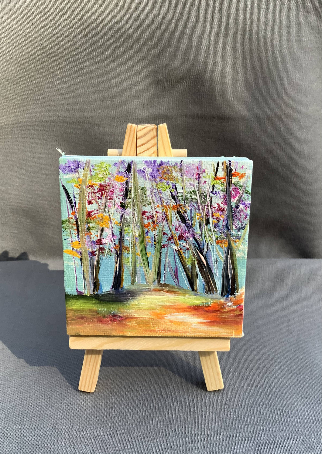 Mini oil painting of a colorful forest