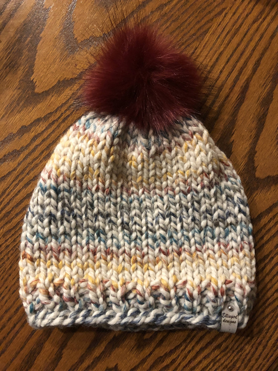 Hand knitted hat with faux fur pompom