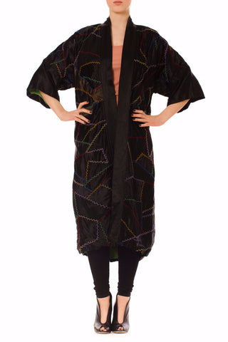 Lush black silk coat from the 1920s with multi-color embroidery