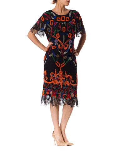1980S  Black Beaded Silk Chiffon Tribal Inspired Cocktail Dress With Fringe Hem & Cut Out Back