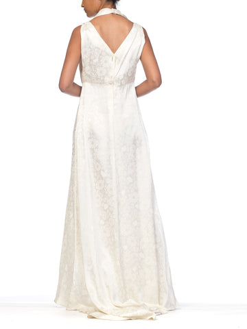 MORPHEW COLLECTION Ivory Floral Rayon Satin Bias Cut  Gown With Lace Trim & Train
