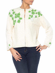 Cream Colored Sweater With Green and White Floral Beading