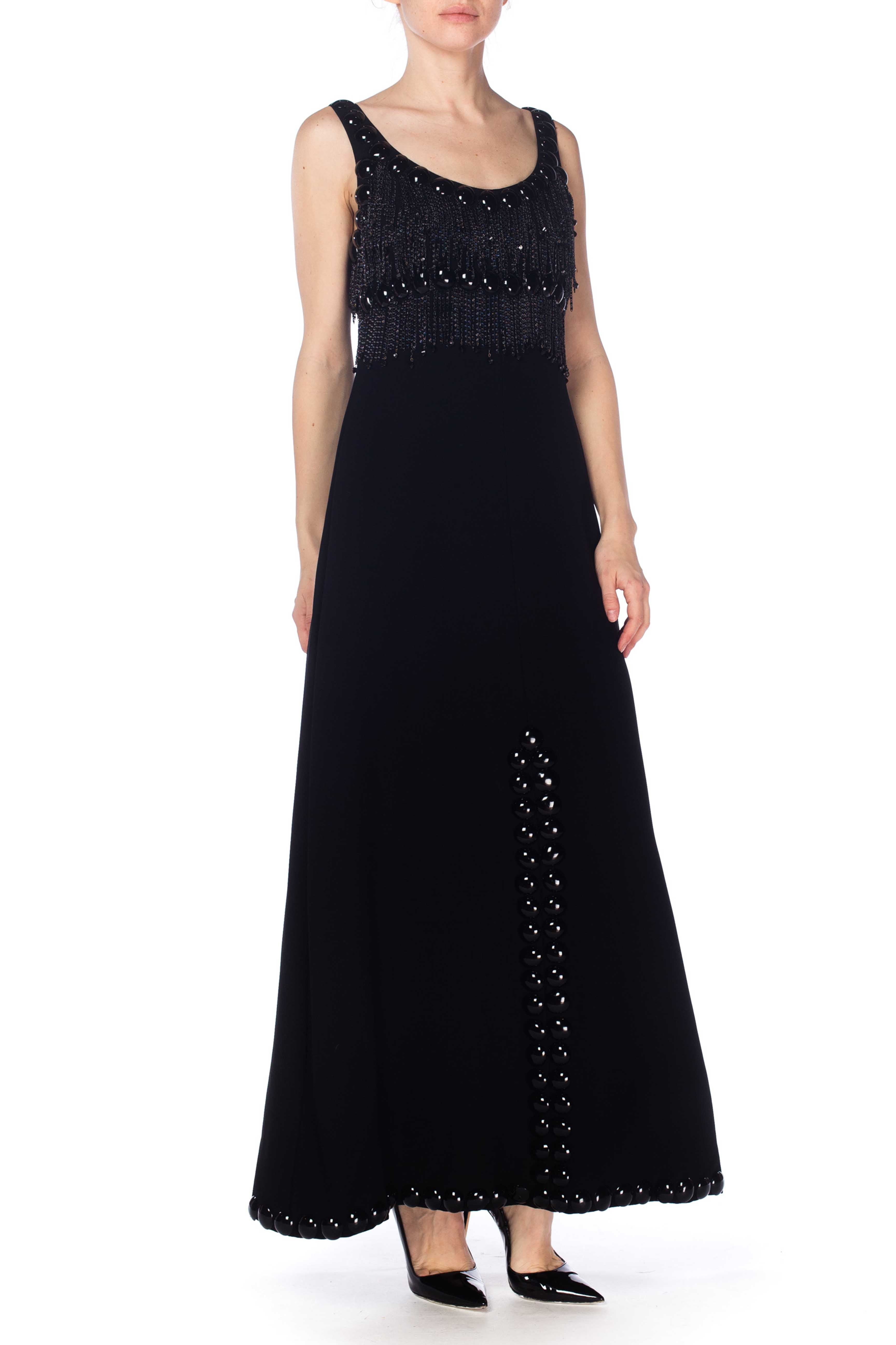 1960S Loris Azzaro Black Rayon Crepe Empire Waist Gown With Futuristic Domed Pailettes & Chain Fringe