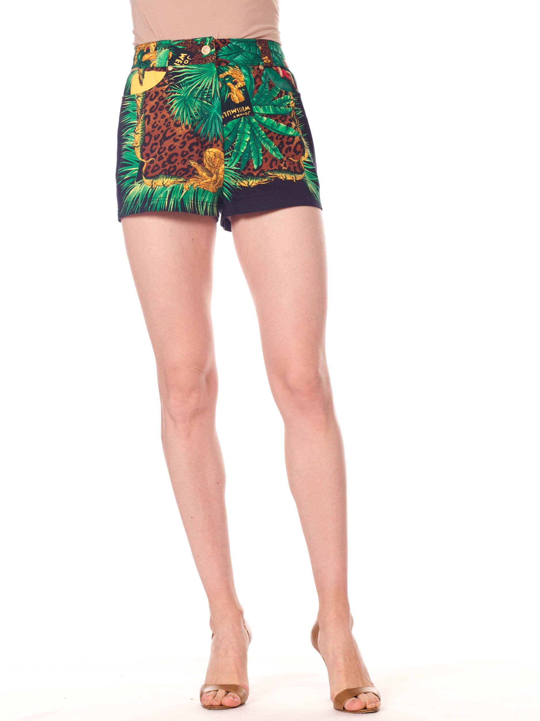 1990S Gianni Versace Cotton Denim Tarzan Leopard Jungle Print Shorts | Hamptons | 24hrs- Free Return policy | US Free Shipping | Pre-owned Clothing | Sustainable fashion | Women Vintage Clothing | Vintage Clothing Store | Vintage Versace | Vintage Shorts