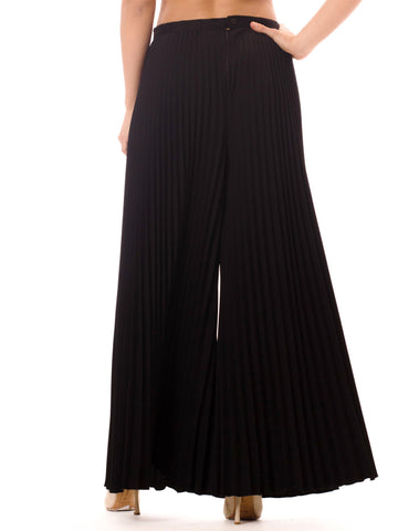 1970S Polyester  Funky And Chic These Black, Wide Leg Pants Feature Tight, Well-Ordered Pleats Down The Entire Length. Rest On Hipline. Design Combined With Long Pleats, Create A Playful Yet Sophisticated Garment. Back Zip Closure.