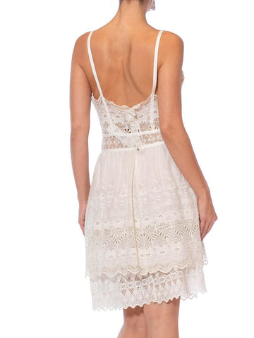 MORPHEW COLLECTION White Cotton Victorian Lace Mini Dress With Cutout Bow Front