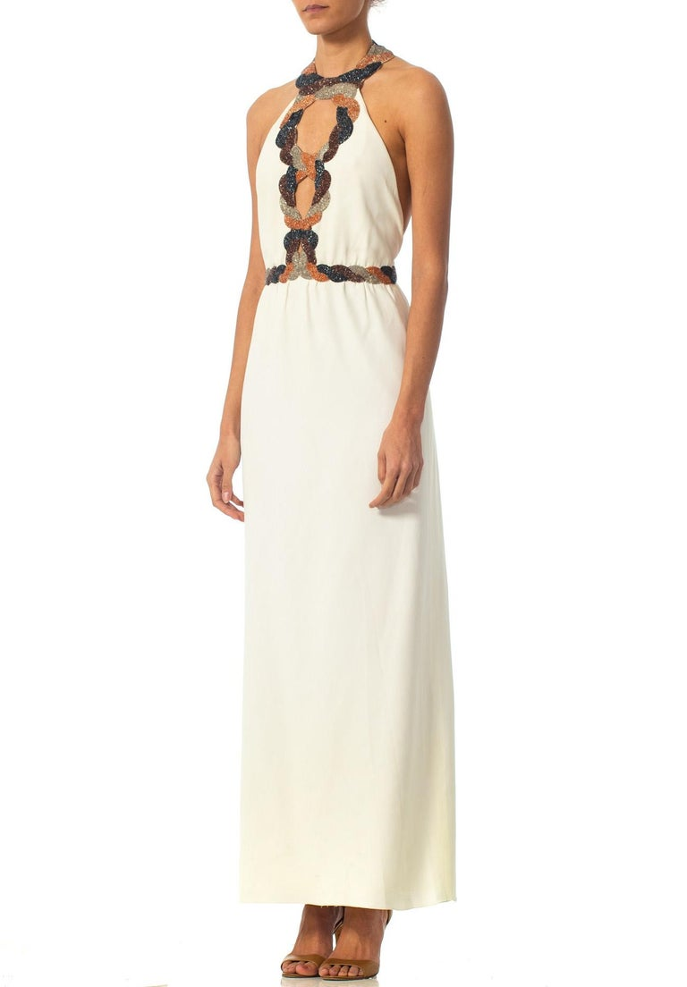 1970S LORIS AZZARO Ivory Hand Beaded Silk Crepe Backless Halter Gown With Cut-Outs