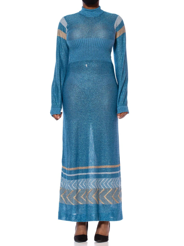 1970S Aquamarine Blue Poly/Lurex Knit Long Sleeved Maxi Dress With A Gold & Silver Deco Border