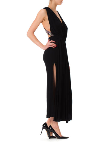 1970s Glam Black Silk Deep Cut Plunging Neckline Long Dress with Embroidered Asian Straps