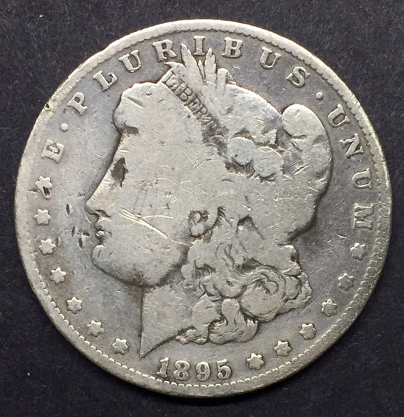 1895-O Morgan Silver Dollar. F