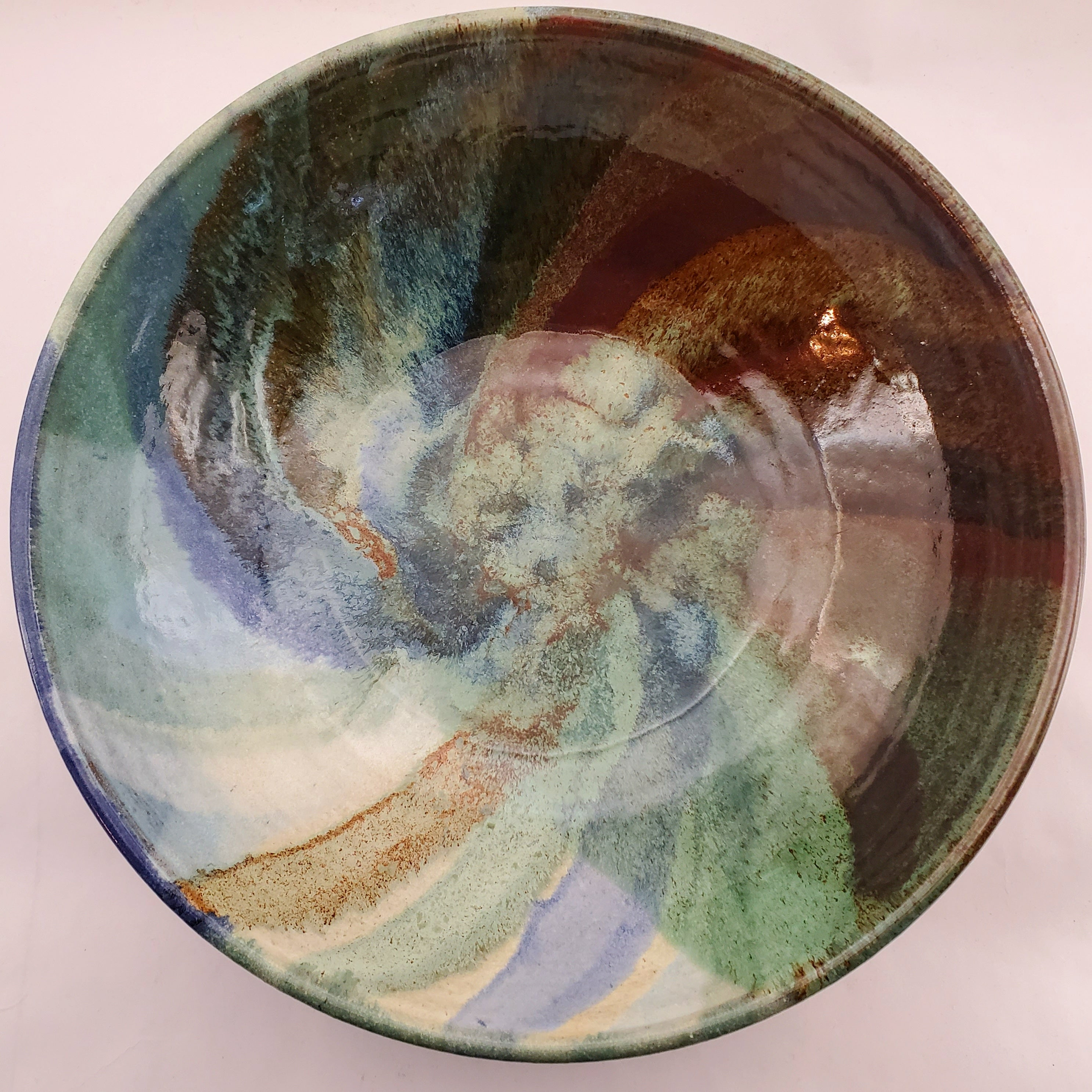 Beautiful, Signature style bowl glazed in blues, greens and browns. Handmade on Vashon Island by Abraham McBride Pottery. Local ceramics artist, Seattle Washington. Small business, Made in the USA.
