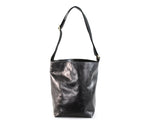 Black leather bucket bag by Shana Luther