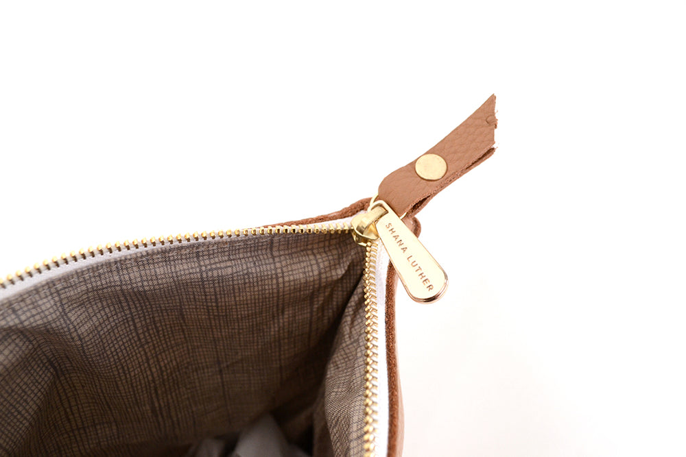 Load image into Gallery viewer, Camel fold over leather clutch