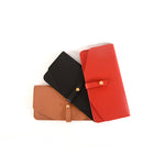 Veg Tan leather wallets by Shana Luther